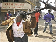 A Kikuyu man is attacked by rioters in the Mathare slum, Nairobi, Kenya, in February 2008