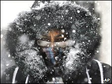 A woman during a snowstorm in Montreal, Canada, 21 December 2008