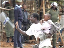 A father tries to get his son to school in Nairobi's Kibera slum in April 2008
