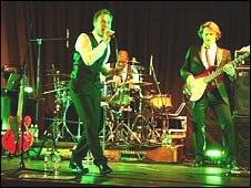 Jason Donovan performing on stage