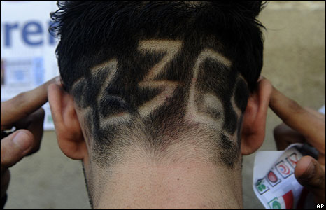 "Juan Fernandez with ""32365"" shaved into the hair at the back of his head"