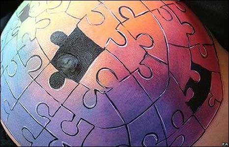 A puzzle painted on a pregnant tummy