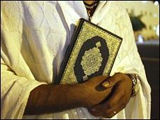 Muslim with Koran