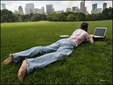 Man using laptop in the field