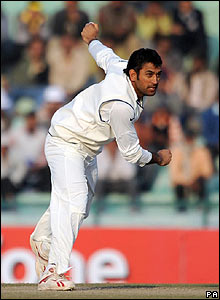India's wicketkeeper Dhoni comes on to bowl the last over of the day