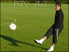 Ali Abbas playing football; Photo: Hugh Sykes