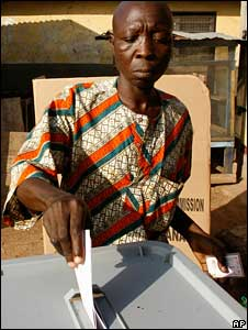 A Ghanaian man votes in the first round