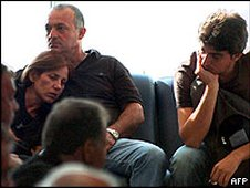 Bereaved relatives wait at Larnaca Airport, Cyprus, to fly to Greece 2005