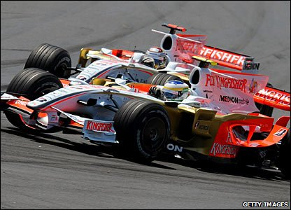 Giancarlo Fisichella (front) and Adrian Sutil of Force India