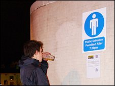 Man in front of 'urination sign' in Nottingham