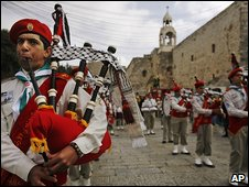 Bagpipers play in front of the Church of the Nativity, Bethlehem, 24 December 2008