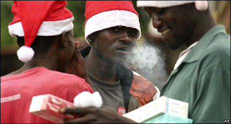 Cigarette and Santa hat vendors in Harare