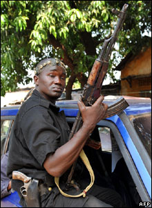 A supporter of the coup attempt in Guinea poses in the capital, Conakry, 24 December 2008