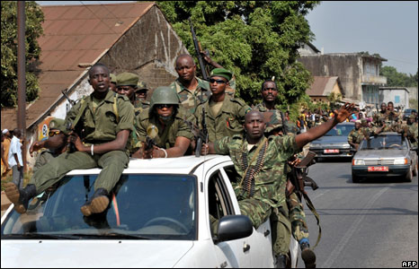 Soldiers backing the coup attempt in Guinea parade in the streets of the capital, Conakry, 24 December 2008