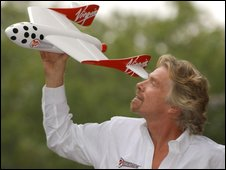 Richard Branson with a model of the Virgin spacecraft