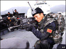 A member of the Chinese navy's special force on the deck of DDG-171 Haikou destroyer