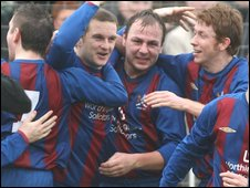 Ards players celebrate after James Wilson's equaliser in the Steel Cup final against Carrick