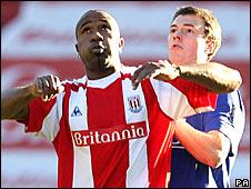 Man Utd's Jonny Evans challenges Stoke's Ricardo Fuller