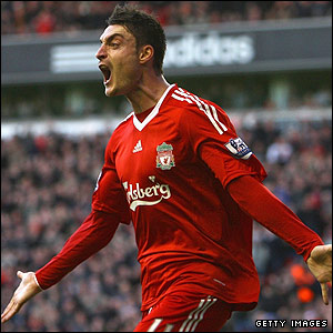 Both men are delighted when Albert Riera prods the home team into the lead from a Steven Gerrard corner