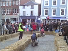 Barrel rolling compeititors race in Denbigh