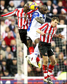 Nyron Nosworthy and Jason Roberts challenge for a header