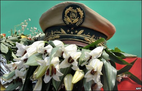 Guinean President Lansana Conte's cap sits on his coffin