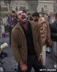A man is overcome with emotion in Rawalpindi soon after the attack which killed Benazir Bhutto on 27 December 2007