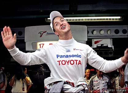 Ralf Schumacher celebrates his pole position in Japan