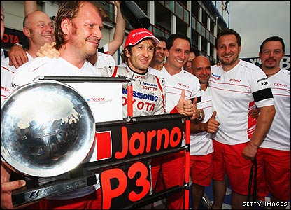 Jarno Trulli celebrates collecting third place at the 2008 France Grand Prix