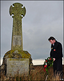 Billy Martin lays a wreath for Robert Cunningham on a moor near Ballantrae