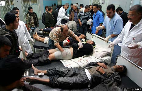 Palestinians wounded during an Israeli air strike are treated in hospital in Rafah