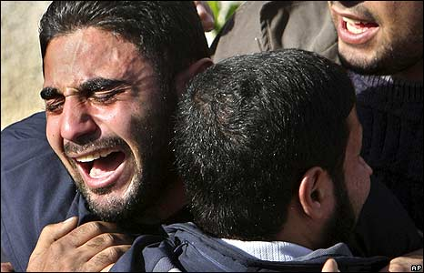 Relatives of Hamas security force officers react after seeing their bodies