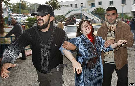 Palestinians rush an injured woman to hospital in Gaza City