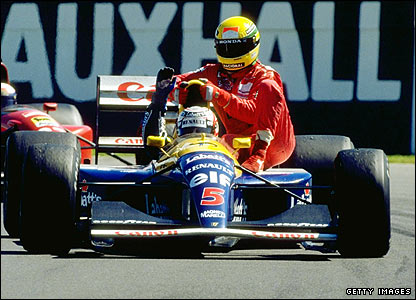 Nigel Mansell gives Ayrton Senna a lift after winning the 1991 British Grand Prix