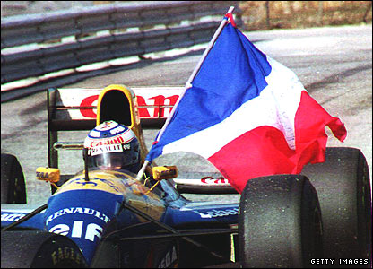 Alain Prost celebrates winning the 1993 title at the Portuguese Grand Prix