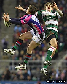 Quins wing Tom Williams (left) and Toby Flood compete for a high kick