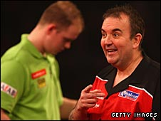 Phil Taylor (right) trounced Dutch ace van Gerwen