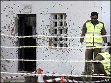 Sri Lankan police investigate the site of a blast in Wattala, Colombo