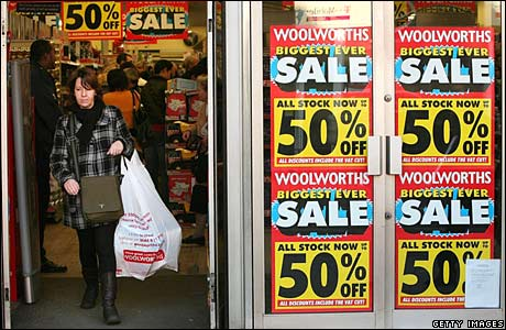 Shopper leaves the sale at a London store
