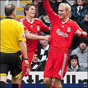 Hyypia celebrates his goal with Daniel Agger