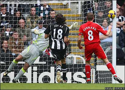 Gerrard watches as his shot goes in off the post