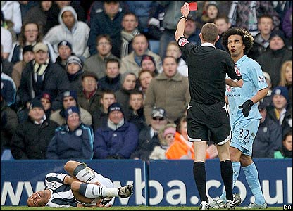 Benoit Assou-Ekotto receives a red card