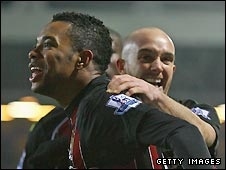 Robinho (left) celebrates his late equaliser for Man City