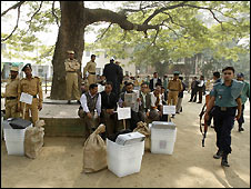 Security personnel guard polling boxes in Dhaka, Bangladesh - 28/12/2008