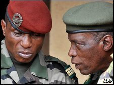 Captain Moussa Dadis Camara (left) talking to General Mamadou Bah Toto Camara
