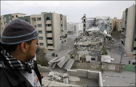 A Palestinian man looks at damage to the Islamic University, Gaza, 29 December 2008