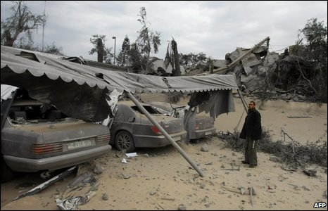 A Palestinian man looks at wreckage of the governor's house in Gaza City, 29 December 2008