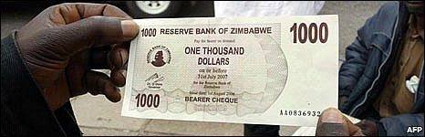 Zimbabwean holds a newly-unveiled Z$1,000 banknote on 1 August 2008