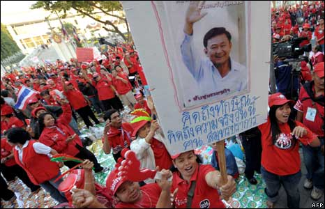 Protesters with a sign of ex-PM Thaksin
