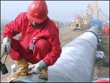 Chinese workers mend a gas pipeline in Luoyang, Henan province, in central China on 11 December